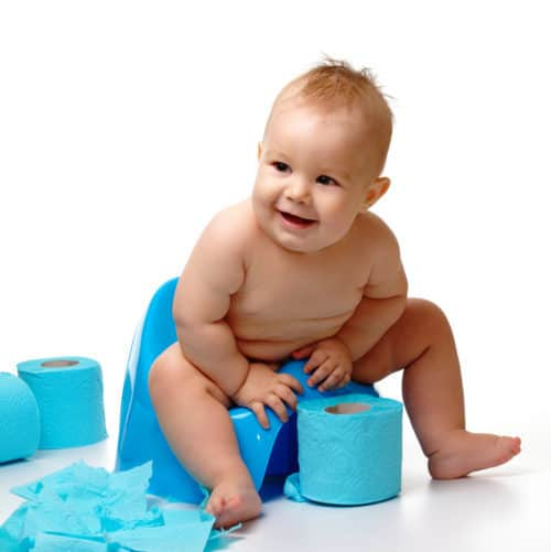 Child on potty play with toilet paper, isolated over white. Remedies for constipation.