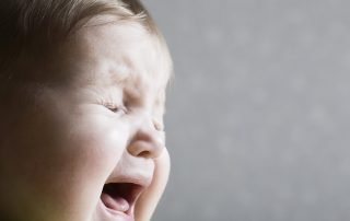 Closeup of baby crying.